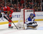 Ryan Miller of the St Louis Blues stops a shot by patrick Kane of the Chicago Blackhawks in Game Six of the First Round of the 2014 NHL Stanley Cup...