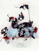 Ryan Miller of the United States makes a save in traffic during the ice hockey men's gold medal game between USA and Canada on day 17 of the...