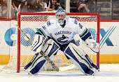 Ryan Miller of the Vancouver Canucks gets ready to make a save against the Arizona Coyotes at Gila River Arena on February 10 2016 in Glendale Arizona