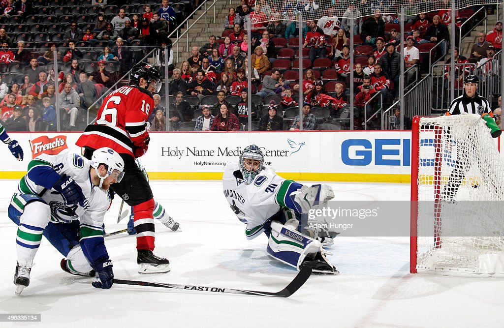 Ryan Miller of the Vancouver Canucks gives up the gamewinning goal to Kyle Palmieri of the New Jersey Devils during overtime at the Prudential Center...