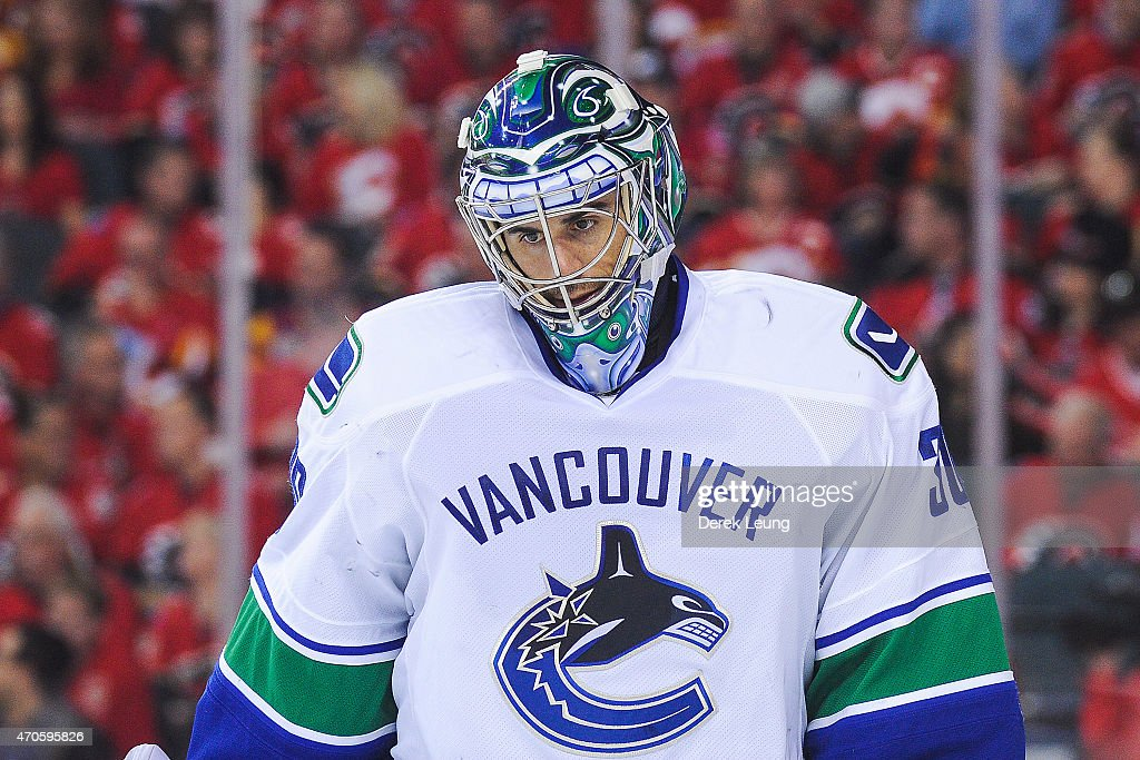 Ryan Miller of the Vancouver Canucks looks during a stoppage in play against the Calgary Flames in Game Four of the Western Quarterfinals during the...