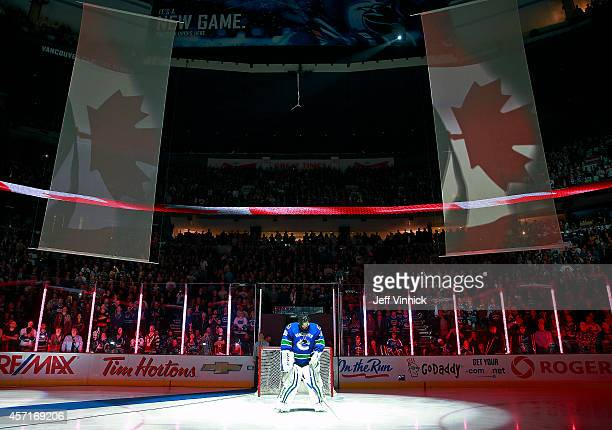 Ryan Miller of the Vancouver Canucks looks on from his crease during their NHL game against the Edmonton Oilers at Rogers Arena October 11 2014 in...