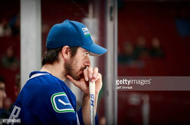 Ryan Miller of the Vancouver Canucks looks on from the bench during their NHL game against the Los Angeles Kings at Rogers Arena March 31 2017 in...