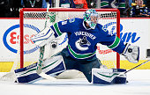 Ryan Miller of the Vancouver Canucks makes a glove save against the Colorado Avalanche during their NHL game at Rogers Arena February 21 2016 in...