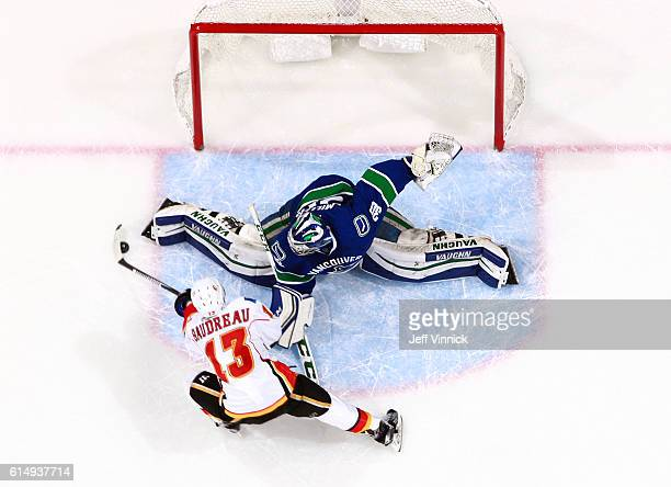 Ryan Miller of the Vancouver Canucks makes a save against Johnny Gaudreau of the Calgary Flames during the shootout in their NHL game at Rogers Arena...