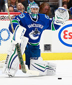 Ryan Miller of the Vancouver Canucks makes a save against the Calgary Flames during Game Five of the Western Conference Quarterfinals during the 2015...