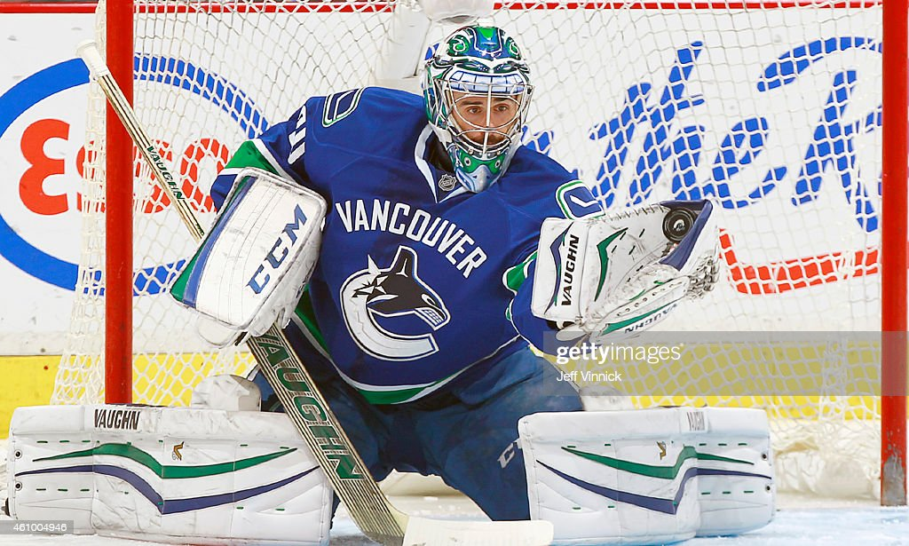 Ryan Miller of the Vancouver Canucks makes a save against the Detroit Red Wings during their NHL game at Rogers Arena January 3 2015 in Vancouver...
