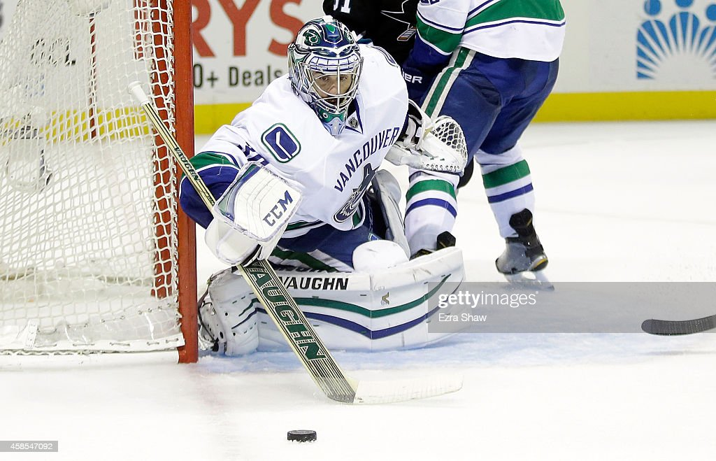Ryan Miller of the Vancouver Canucks makes a save during their game against the San Jose Sharks at SAP Center on November 6 2014 in San Jose...