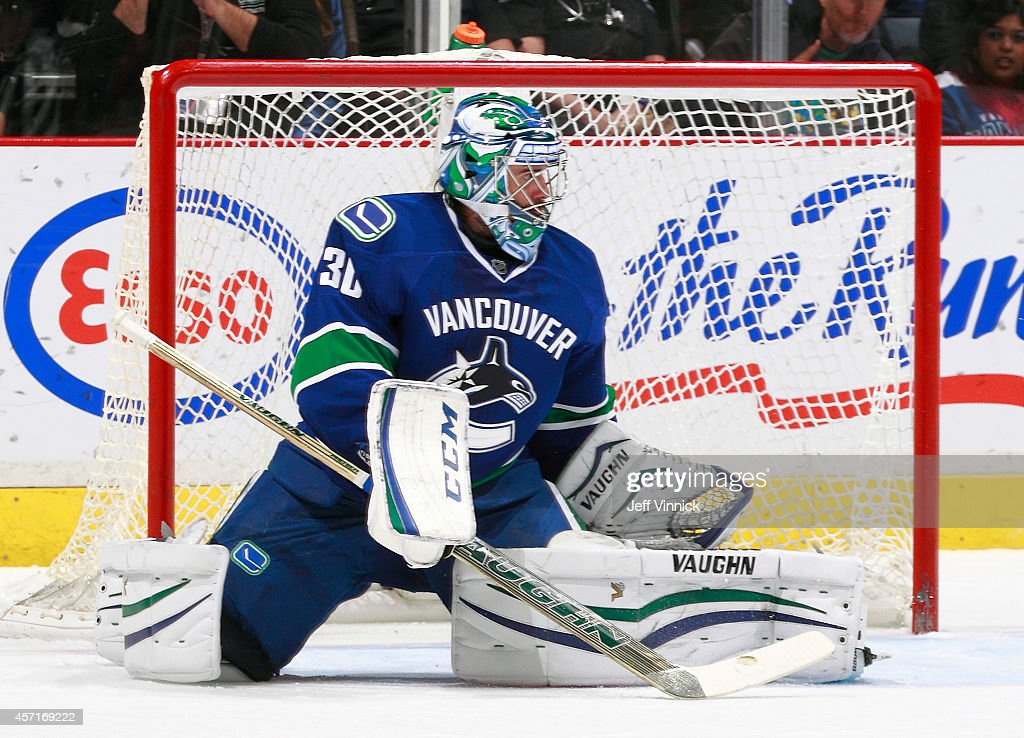 Ryan Miller of the Vancouver Canucks makes a save during their NHL game against the Edmonton Oilers at Rogers Arena October 11 2014 in Vancouver...