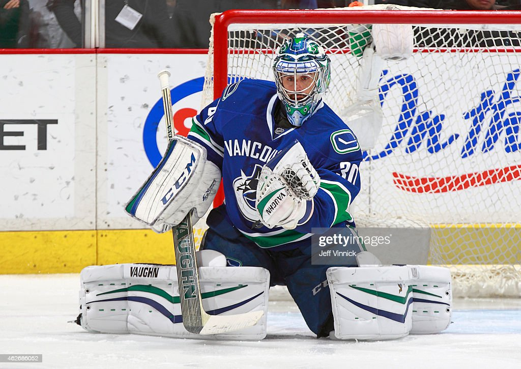 Ryan Miller of the Vancouver Canucks makes a save during their NHL game against the Minnesota Wild at Rogers Arena February 1 2015 in Vancouver...