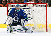 Ryan Miller of the Vancouver Canucks makes a save during their NHL game against the San Jose Sharks at Rogers Arena February 5 2015 in Vancouver...