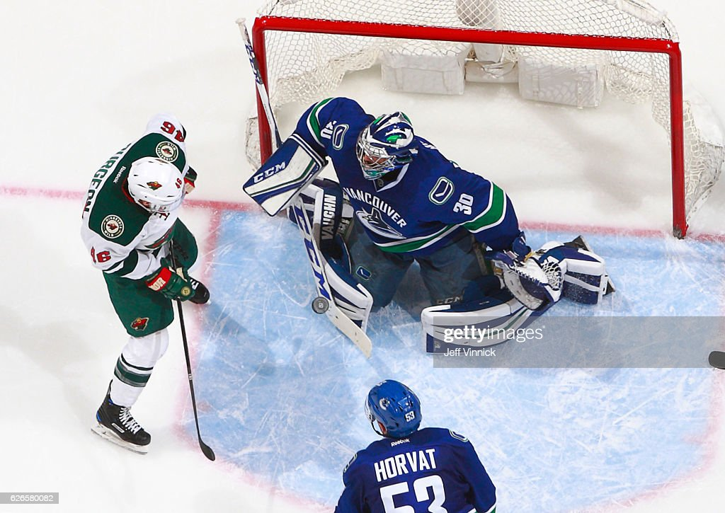 Ryan Miller #30 of the Vancouver Canucks makes a save off the shot of Jared Spurgeon #46 of the Minnesota Wild during their NHL game at Rogers Arena November 29, 2016 in Vancouver, British Columbia, Canada. Vancouver won 5-4.