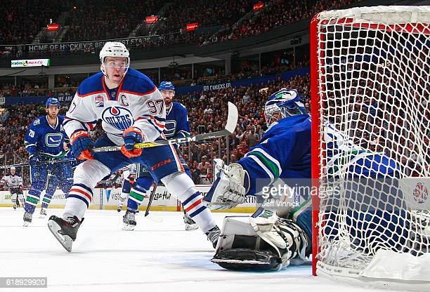 Ryan Miller of the Vancouver Canucks makes a save on a breakaway by Connor McDavid of the Edmonton Oilers during their NHL game at Rogers Arena...