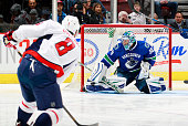 Ryan Miller of the Vancouver Canucks makes a save on Alex Ovechkin of the Washington Capitals during their NHL game at Rogers Arena October 22 2015...