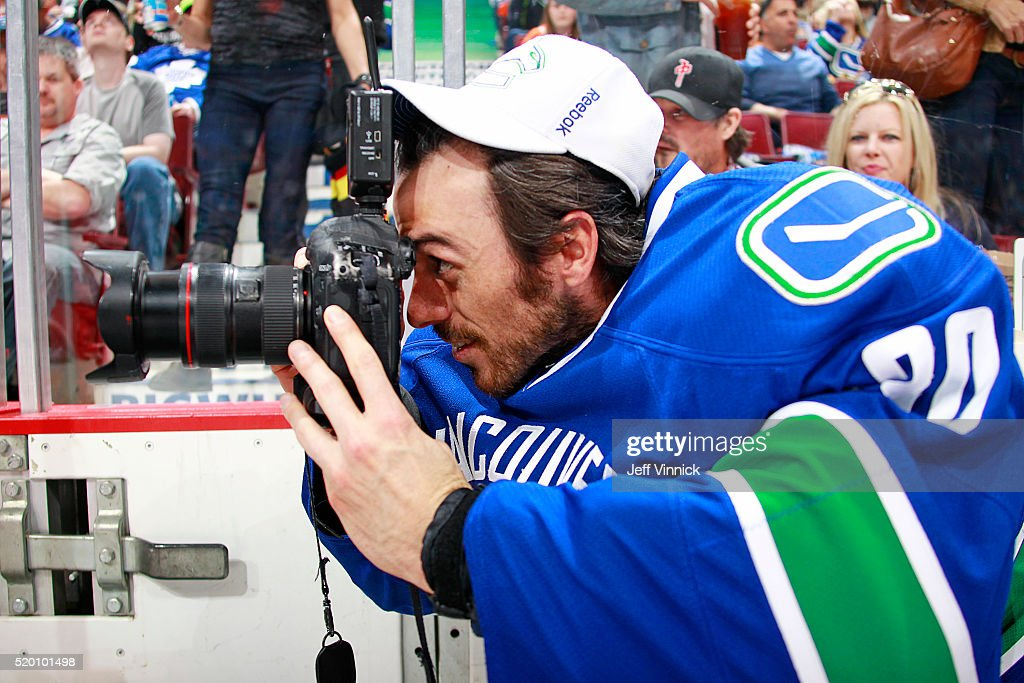 Ryan Miller of the Vancouver Canucks plays photographer during a break in the NHL game against the Edmonton Oilers at Rogers Arena April 9 2016 in...