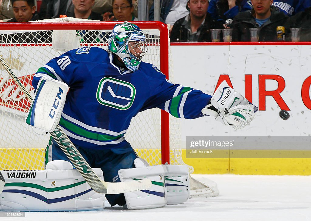 Ryan Miller of the Vancouver Canucks plays the puck against the Anaheim Ducks during their NHL game at Rogers Arena January 27 2015 in Vancouver...