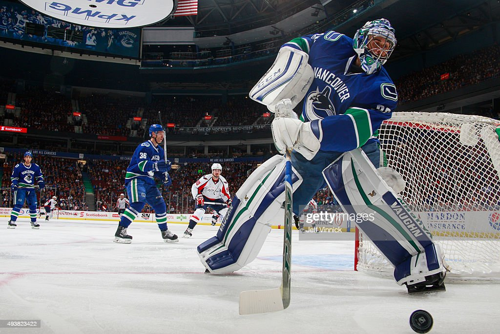 Ryan Miller of the Vancouver Canucks plays the puck against the Washington Capitals during their NHL game at Rogers Arena October 22 2015 in...