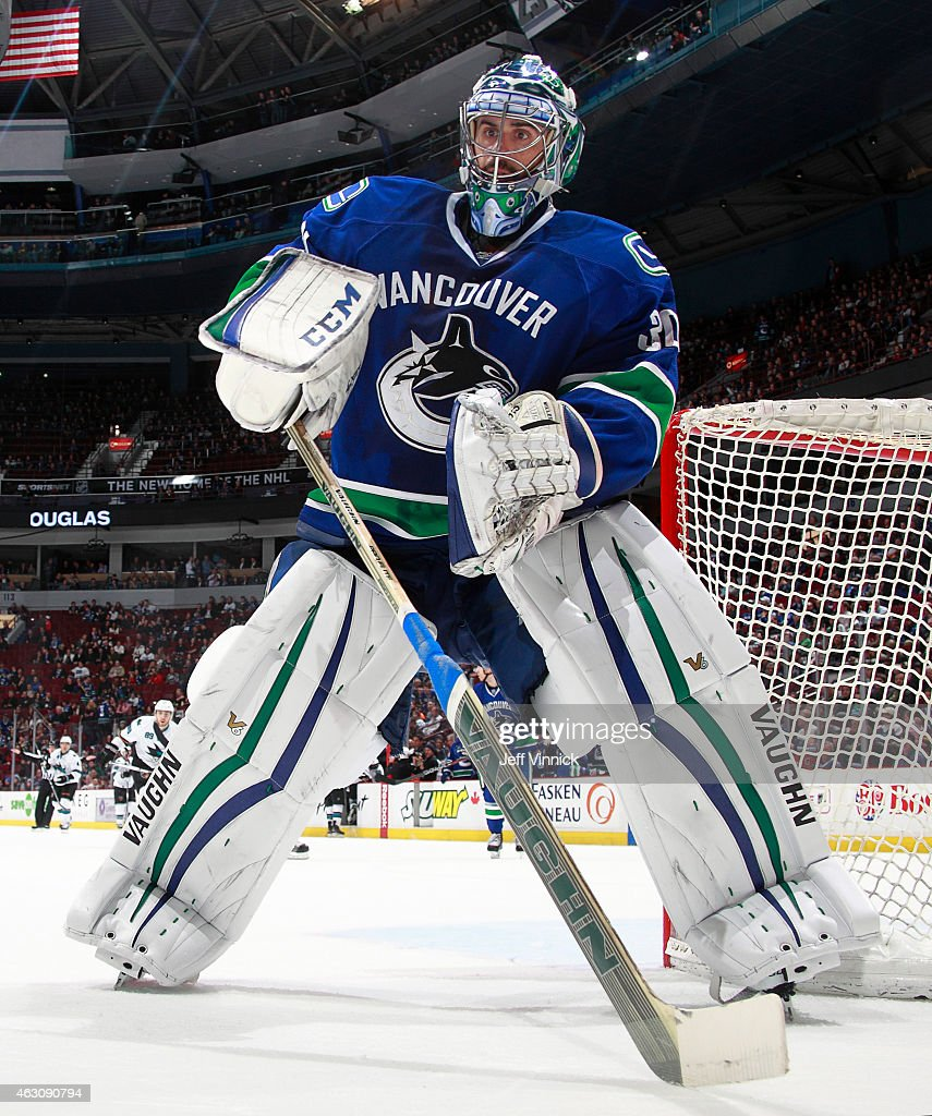Ryan Miller of the Vancouver Canucks plays the puck during their NHL game against the San Jose Sharks at Rogers Arena February 5 2015 in Vancouver...