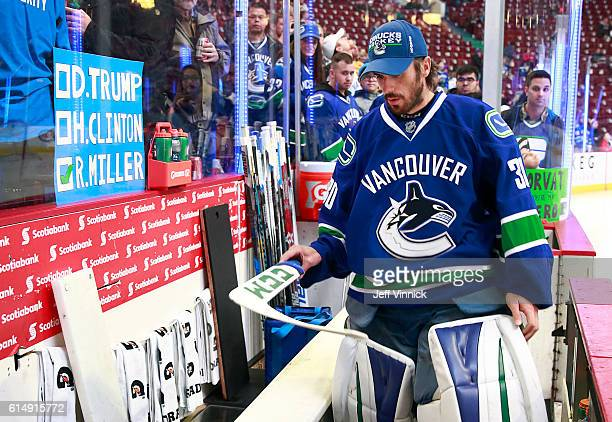 Ryan Miller of the Vancouver Canucks prepares to take to the ice for the pregame warmup before their NHL game against the Calgary Flames at Rogers...