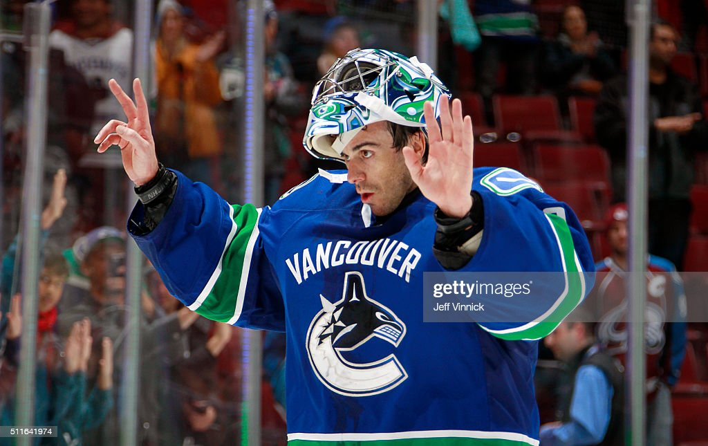 Ryan Miller #30 of the Vancouver Canucks salutes the fans after beinbg named the first star against the Colorado Avalanche during their NHL game at Rogers Arena February 21, 2016 in Vancouver, British Columbia, Canada. Vancouver won 5-1.