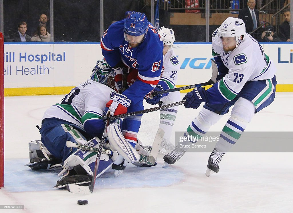 Ryan Miller #30 of the Vancouver Canucks stops Rick Nash #61 of the New York Rangers during the overtime period at Madison Square Garden on January 19, 2016 in New York City. The Rangers defeated the Canucks 3-2 in overtime.
