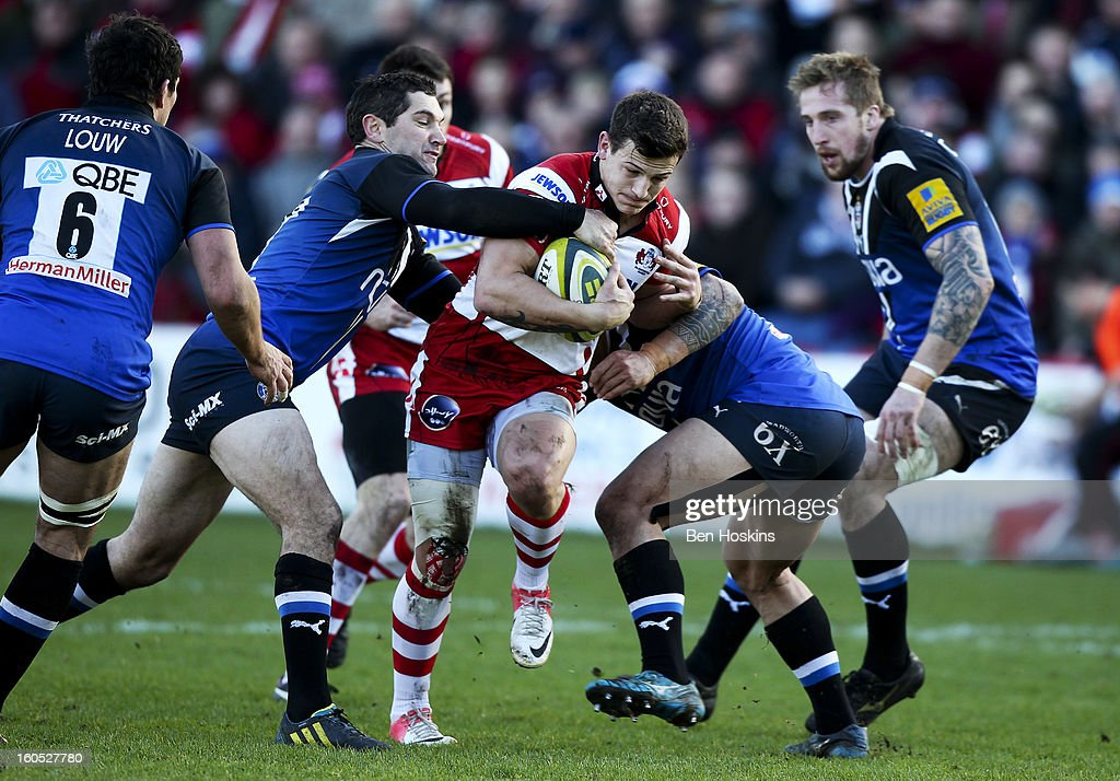 Ryan Mills of Gloucester is tackled by Stephen Donald of Bath (L) during the LV= Cup match between Gloucester and Bath at the Kingsholm Stadium on February 2, 2013 in Gloucester, England.