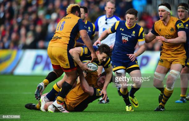 Ryan Mills of Worcester Warriors is tackled by Marc Jones of Bristol Rugby during the Aviva Premiership match between Worcester Warriors and Bristol...