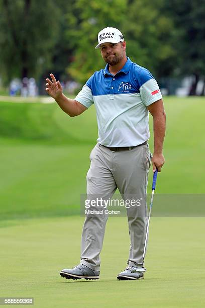Ryan Moore acknowledges the crowd after his birdie on the ninth hole during the first round of the John Deere Classic at TPC Deere Run on August 11...