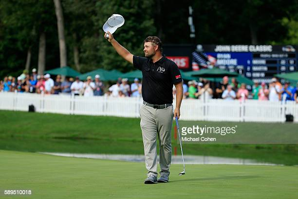 Ryan Moore acknowledges the crowd after his winning putt on the 18th hole during the final round of the John Deere Classic at TPC Deere Run on August...