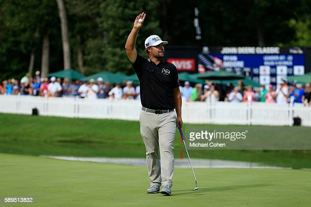 Ryan Moore acknowledges the crowd after his winning putt on the 18th green during the final round of the John Deere Classic at TPC Deere Run on...