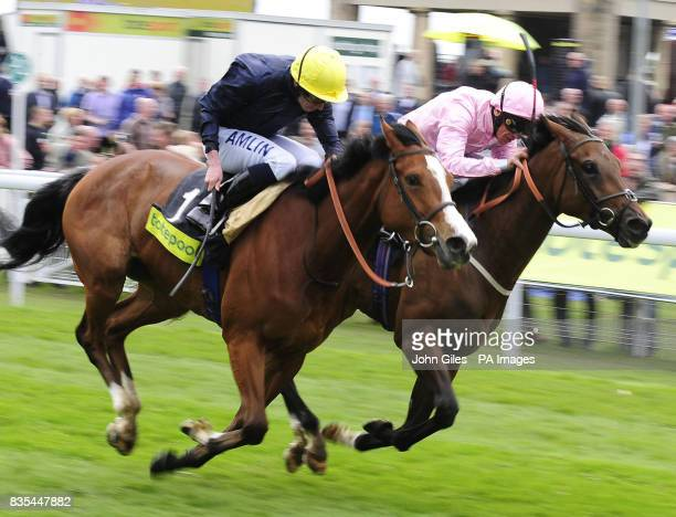 Ryan Moore and Crystal Capella are narrow winners over Frankie Dettori and Dar Re Mi in the Totepool Middleton Stakes at York Racecourse