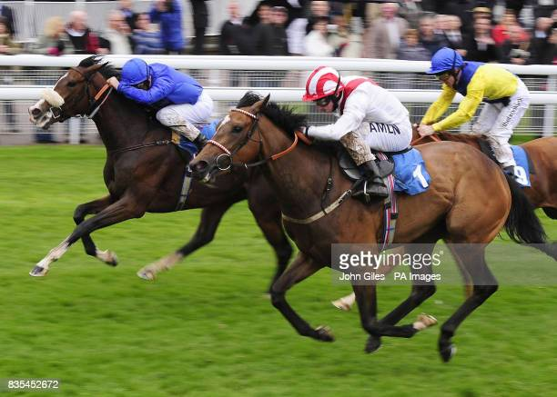 Ryan Moore and Nashmiah go on to beat Frankie Dettori and Moonlife to win the Michael Seely Memorial Fillies Stakes at York Racecourse