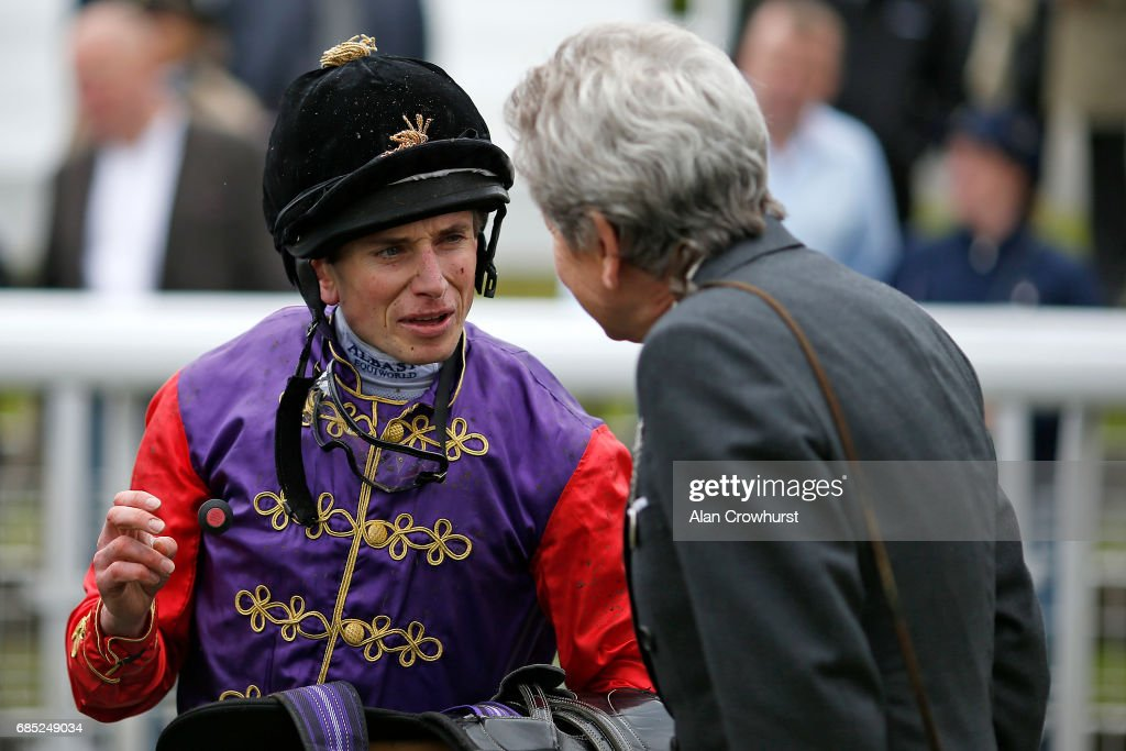 Ryan Moore chats to John Warren after riding Dartmouth to win The Betway Yorkshire Cup at York racecourse on May 19, 2017 in York, England.