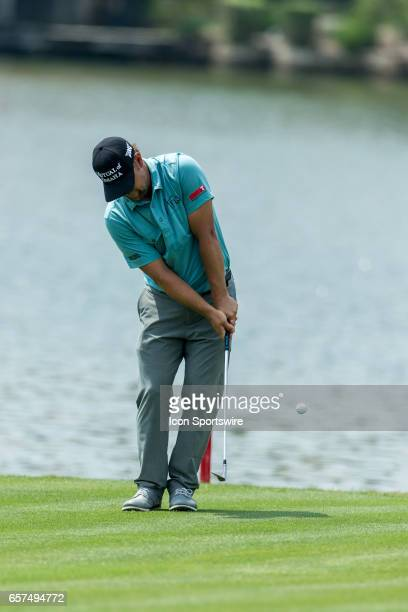 Ryan Moore chips close to the pin and Jordan Spieth allows Ryan Moore to pick up for birdie during the third round of the WCGDell Technologies Match...
