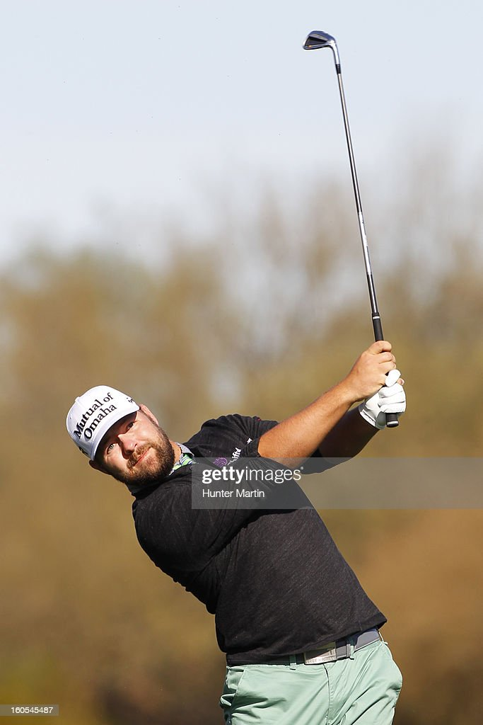 Ryan Moore hits his second shot on the second hole during the third round of the Waste Management Phoenix Open at TPC Scottsdale on February 2, 2013 in Scottsdale, Arizona.