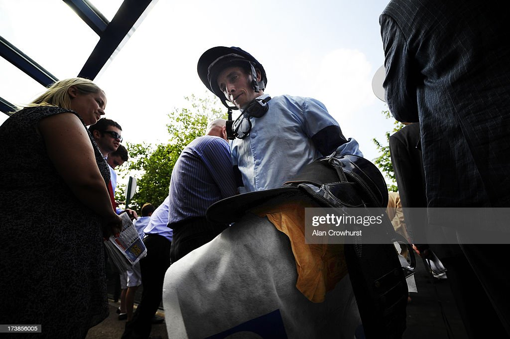 Ryan Moore makes his way back to the weighing room at Leicester racecourse on July 18, 2013 in Leicester, England.