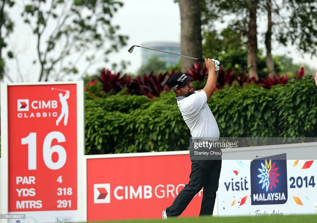 Ryan Moore of of USA plays a tee shot on the 16th hole during round two of the CIMB Classic at Kuala Lumpur Golf & Country Club on October 25, 2013 in Kuala Lumpur, Malaysia.