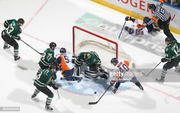 Ryan Moore of the Flint Firebirds is about to get stopped by Tyler Parsons of the London Knights during an OHL game at Budweiser Gardens on March 17...