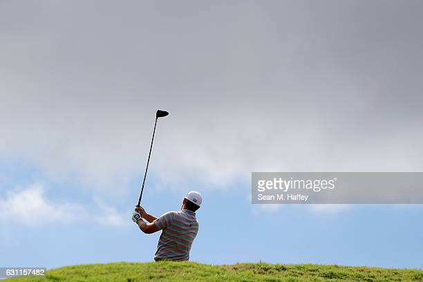 Ryan Moore of the United States plays his shot from the fifth tee during the third round of the SBS Tournament of Champions at the Plantation Course...