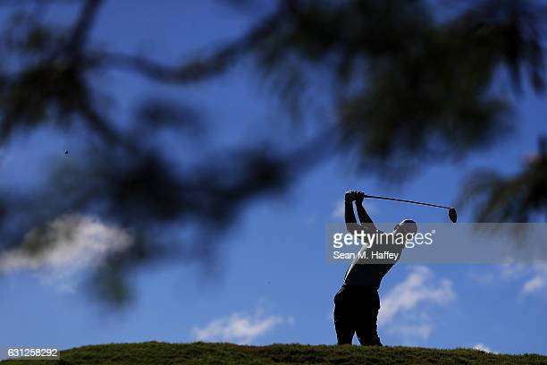 Ryan Moore of the United States plays his shot from the fifth tee during the final round of the SBS Tournament of Champions at the Plantation Course...