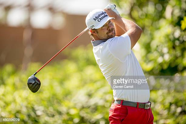 Ryan Moore of the United States plays tee shot at the 18th hole during the continuation of the third round of the 2013 OHL Classic at Mayakoba played...