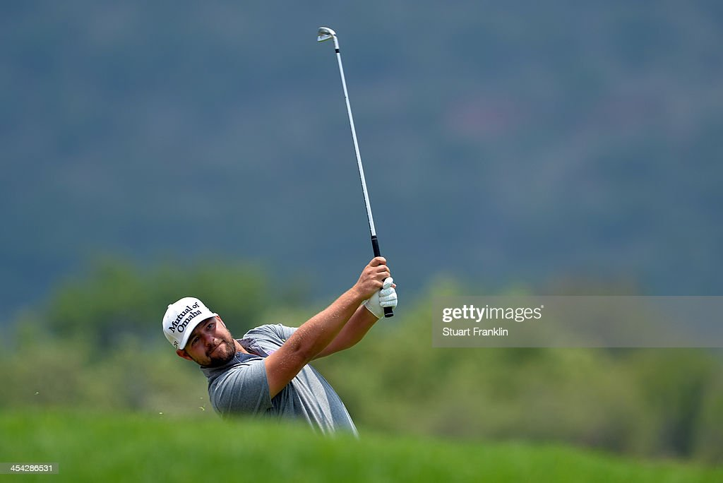 Ryan Moore of USA plays a shot during the final round of the Nedbank Golf Challenge at Gary Player CC on December 8, 2013 in Sun City, South Africa.