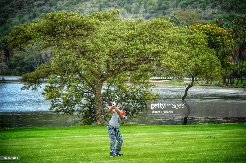 . Ryan Moore of USA plays a shot during the second round of the Nedbank Golf Challenge at Gary Player CC on December 6, 2013 in Sun City, South Africa.
