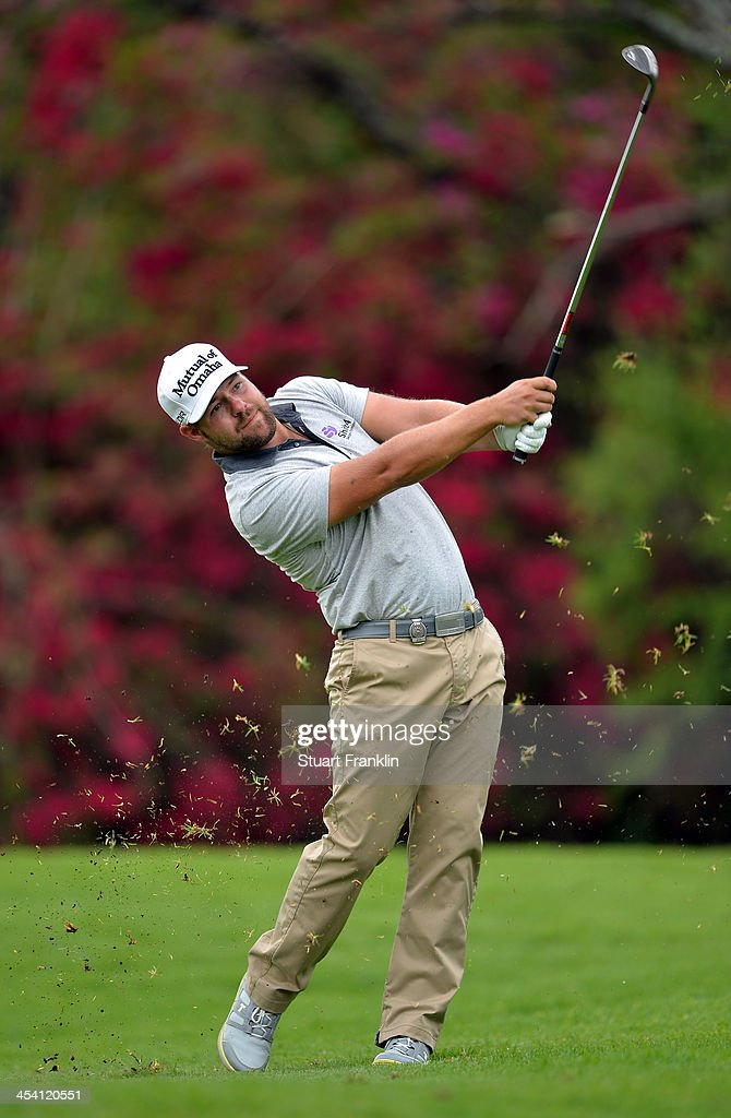 Ryan Moore of USA plays a shot during the third round of the Nedbank Golf Challenge at Gary Player CC on December 7 2013 in Sun City South Africa
