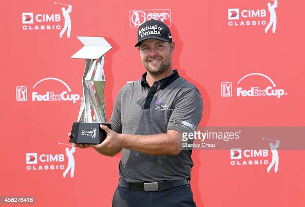 Ryan Moore of USA poses with his trophy after winning during day four of the 2014 CIMB Classic at Kuala Lumpur Golf Country Club on November 2 2014...