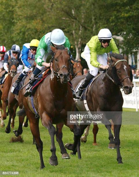 Ryan Moore on Edge Closer in front of George Baker on Balthazaar's Gift to win The Countrywide Steel and Tubes Hopeful Stakes at Newmarket Racecourse