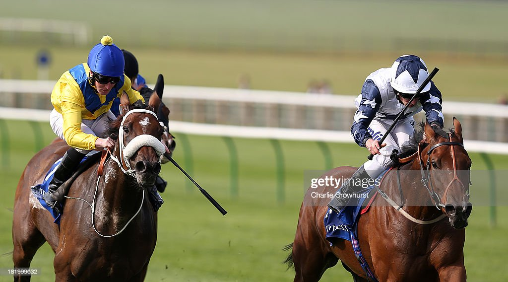 Ryan Moore on Zurigha (R) beats Pat Cosgrave on Igugu (L) to win The Shadwell International Stallions Rosemary Stakes at Newmarket racecourse on September 27, 2013 in Newmarket, England.