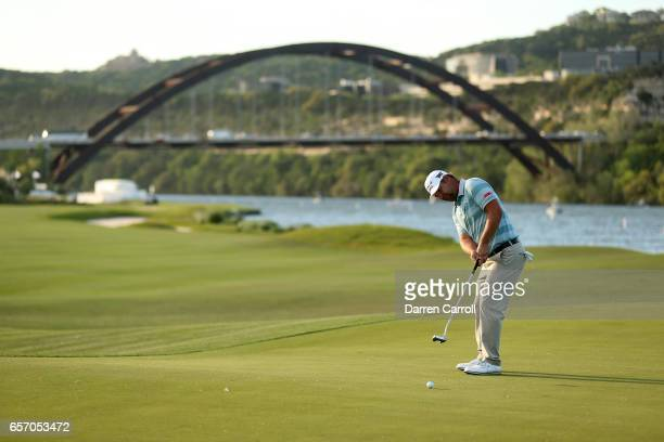 Ryan Moore plays a shot on the 14th hole of his match during round two of the World Golf ChampionshipsDell Technologies Match Play at the Austin...