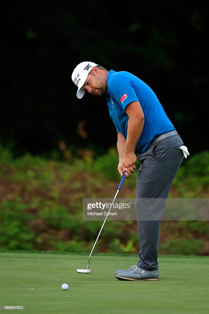 Ryan Moore plays a shot on the 16th hole during the third round of the John Deere Classic at TPC Deere Run on August 13 2016 in Silvis Illinois