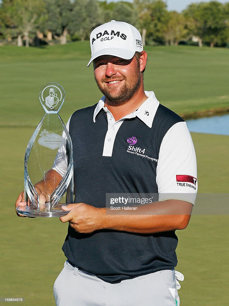 Ryan Moore poses with the trophy on the 18th green after winning the Justin Timberlake Shriners Hospitals for Children Open at TPC Summerlin on October 7, 2012 in Las Vegas, Nevada.